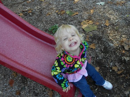 smiling toddler slide